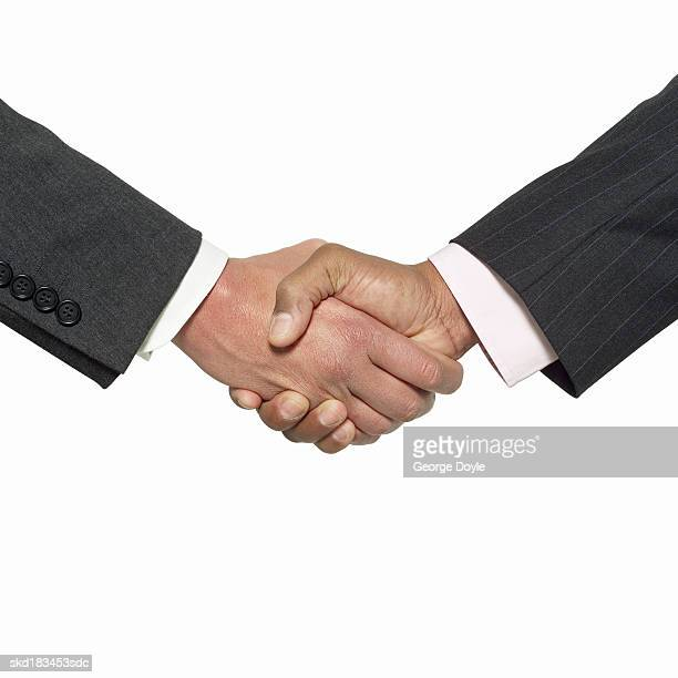 Close up view of two businessmen shaking hands