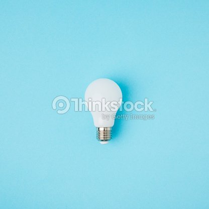 close up view of white light bulb isolated on blue : Stock Photo