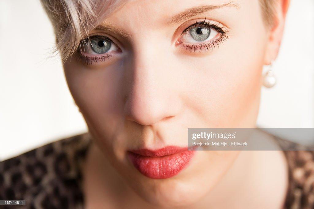 Close up woman looking at camera : Stock Photo