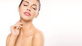 Close up woman portrait with closed eyes. Woman touching her neck. Beauty and skin care concept.