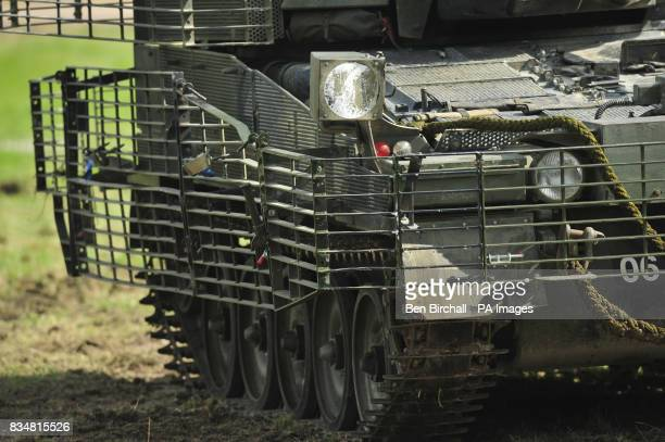 A close view of a Scimitar tank with added body armour in the form of heavy duty metal grids that cause antitank weapons to detonate further from the...