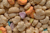 Close view of generic crunchy breakfast cereal with fruit flavored bits.