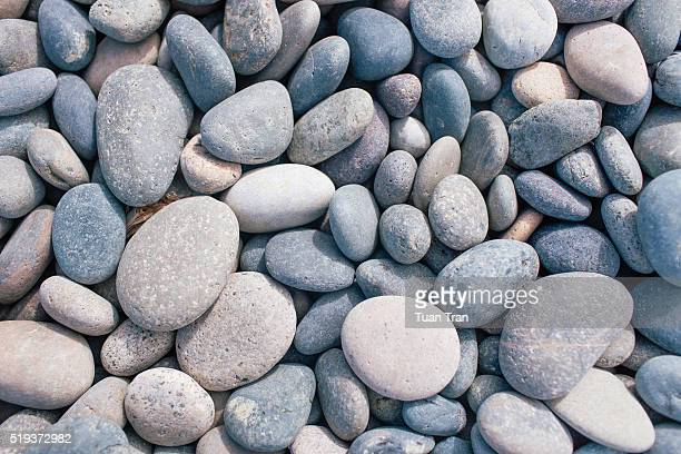 Close view of smooth rocks on the beach, California