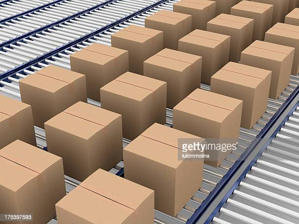 Closed cardboard boxes being conveying on conveyer belt