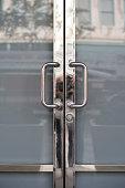 Closed. Chrome door handles of shop/office