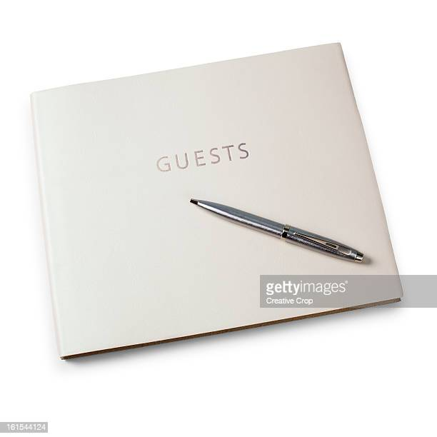 Closed guest book and pen