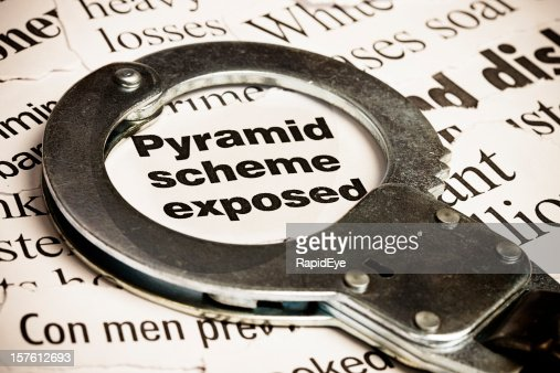 Closed handcuff on headline: pyramid scheme exposed