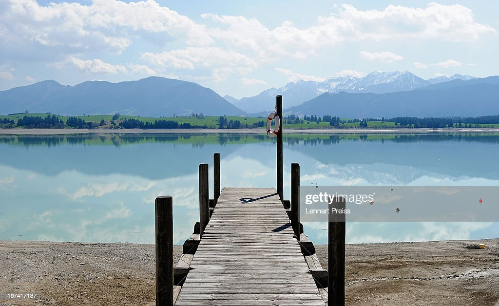 A closed jetty is seen at lake Forggensee on April 25, 2013 near Fuessen, Germany. After a couple of sunny and warm days the weather at the weekend is expected to be unsteady with some rain and dropping temperatures.