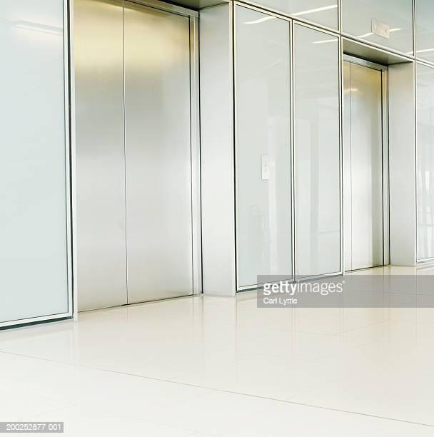 Closed lift doors in office corridor