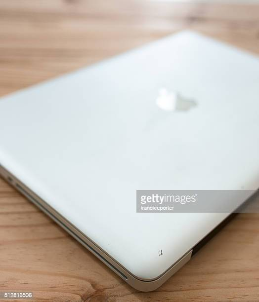 closed macbook pro 15 inch on the table