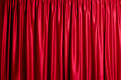 Closed red silk theatre curtains