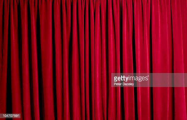 Closed red theatre curtains