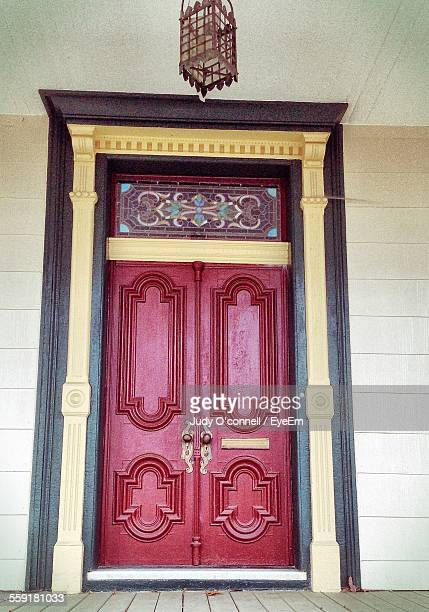 Closed Red Wooden Door Of House