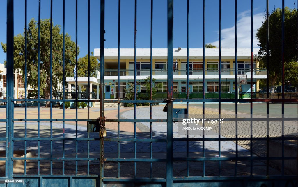 A closed school is pictured during a strike of school teachers in Athens on September 18, 2013. As part of the controversial redeployment plan in the country reeling from six years of recession, civil servants have to accept new posts or spend eight months on reduced salaries as alternative posts are found, with the risk of losing their jobs altogether.