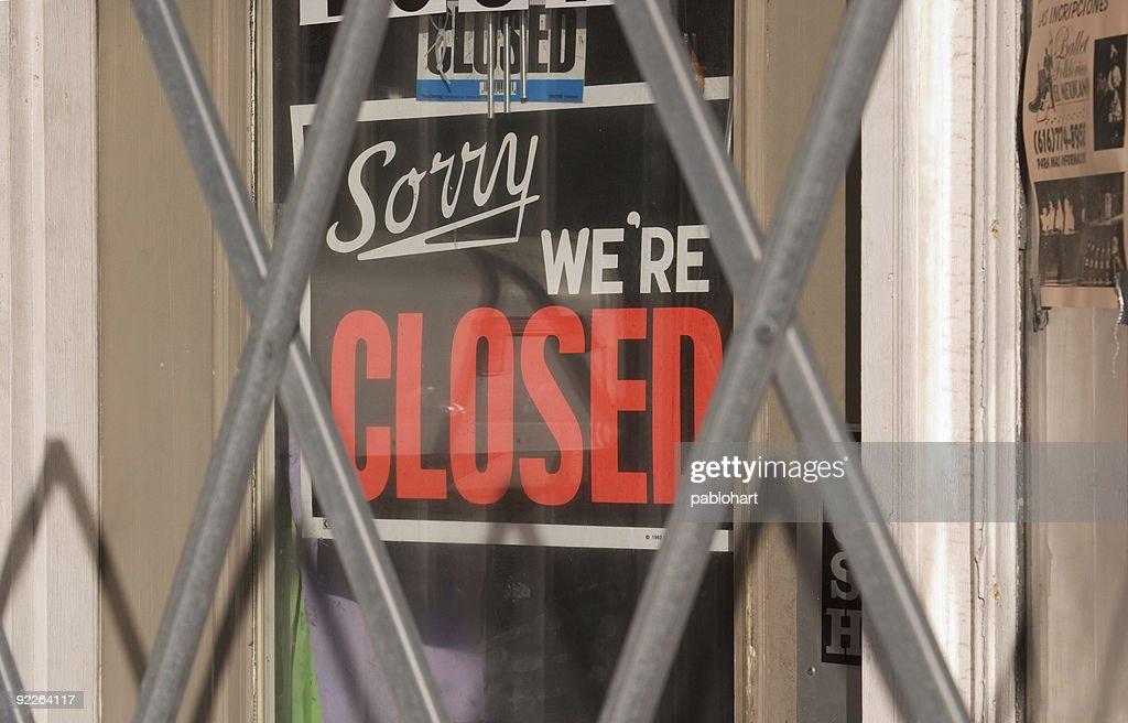 Closed sign behind metal gate