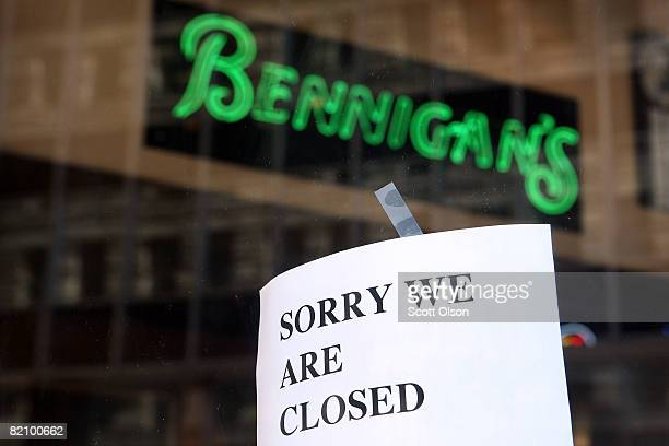 A closed sign hangs on the door of a Bennigan's Grill Tavern restaurant July 29 2008 in downtown Chicago Illinois The corporation that owns...