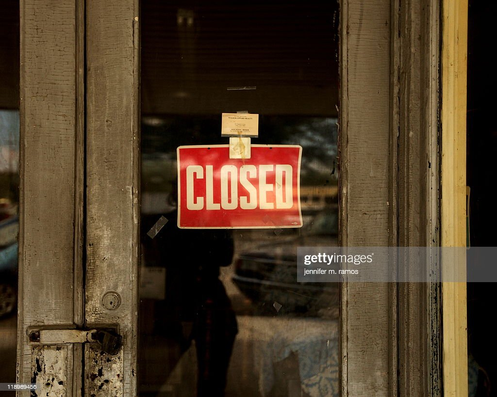 Closed sign on an old set of doors : Stock Photo