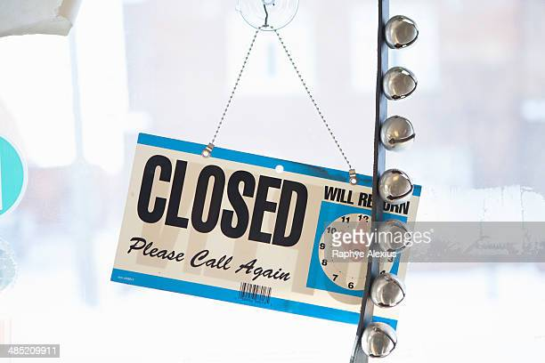 Closed sign on door of small business