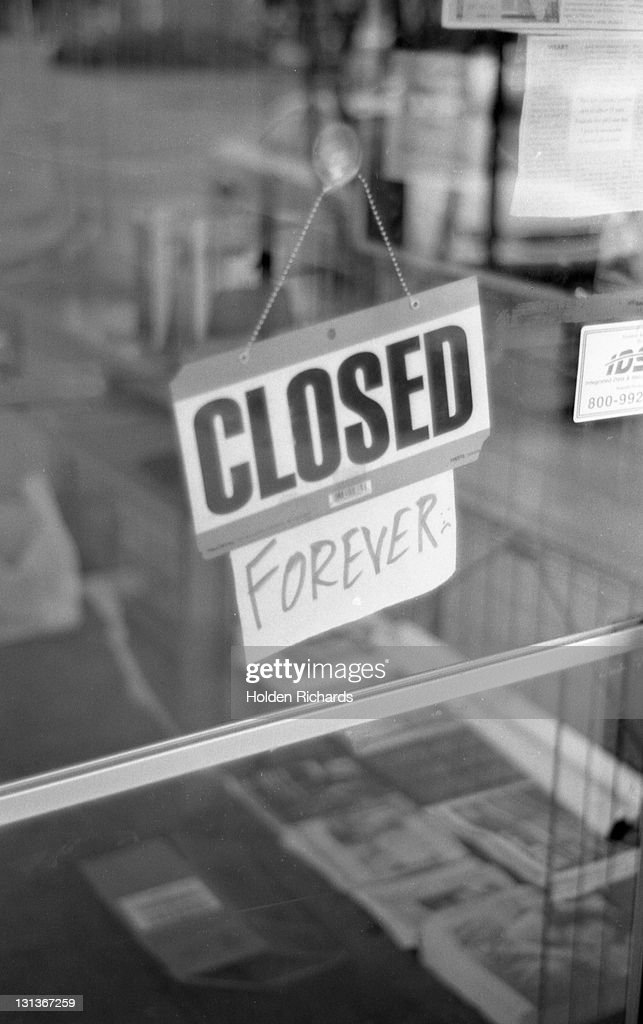 Closed sign on glass door : Stock Photo