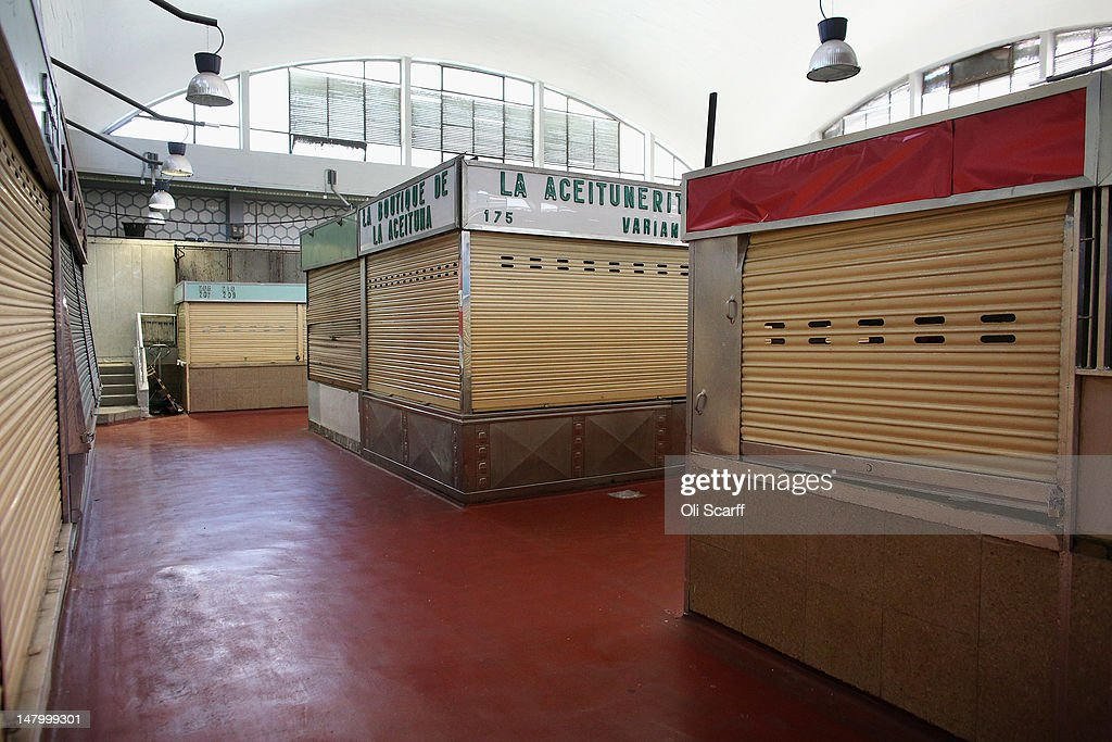 Closed stalls, whose occupants have ceased trading, in an indoor market near the Plaza de Cascorro on July 7, 2012 in Madrid, Spain. Despite having the fourth largest economy in the Eurozone, the economic situation in Spain remains troubled with their unemployment rate the highest of any Eurozone country. Spain is currently administering billions of euros of spending cuts and tax increases in a bid to manage its national debt. Spain also has access to loans of up to 100 billion euros from the European Financial Stability Facility which will be used to rescue the country's banks that have been badly affected by a crash in property prices.