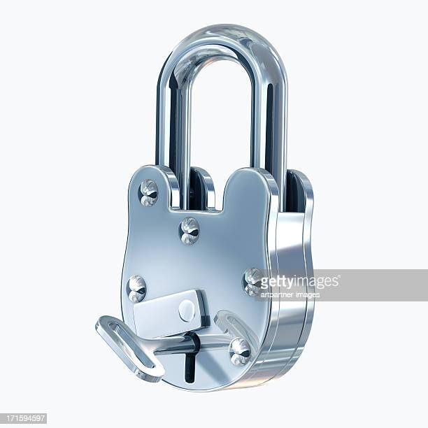 Closed steel padlock with key on white
