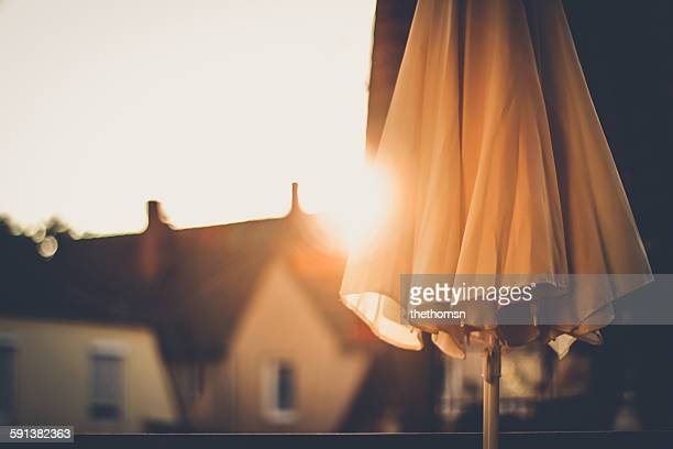Closed sunshade with sunset in urban ambience