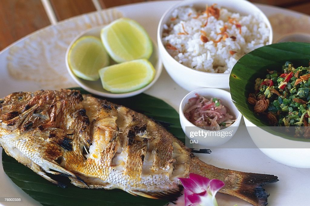 Closed Up Image of a Balinese Meal With Fish, Rice and Vegetables, High Angle View : Stock Photo