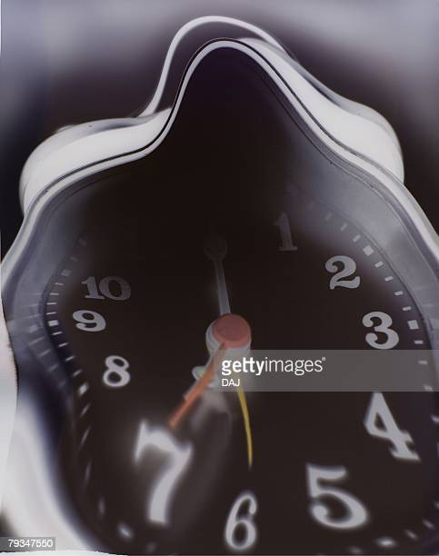 Closed Up Image of a Distorted Clock, Low Angle View, Blurred Motion, CG