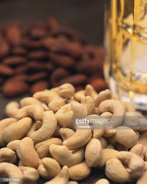Closed Up Image of Different Kinds of Nuts and a Glass of Beer, Differential Focus