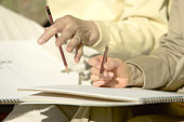 Closed Up Image of Hands Holding a Pencil and Sketching, Differential Focus