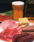 Closed Up Image of Several Different Kinds of Sausages and Hams and a Glass of Beer, Differential Focus