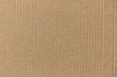 Closed up of brown color corrugated paper board background used as wallpaper, decoration, design element