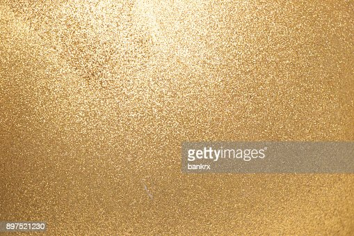 Closed up of metallic gold glitter textured background : Foto stock