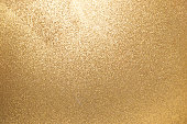Closed up of metallic gold glitter textured background