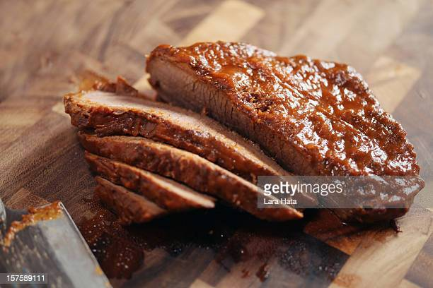 Closed up of sliced brisket on wooden cutting board