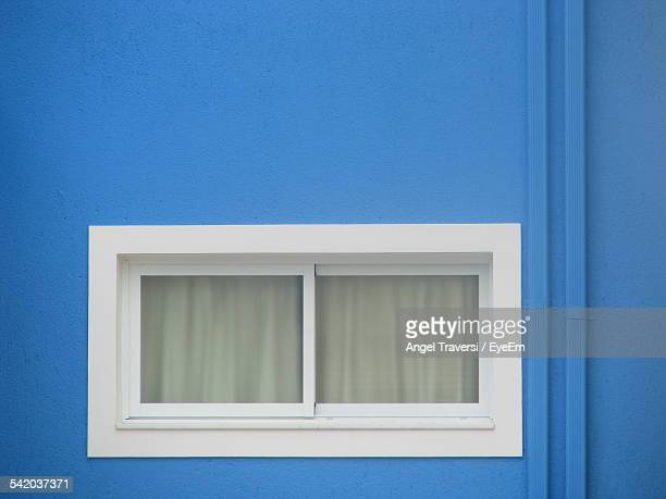 Closed Window On Blue Building