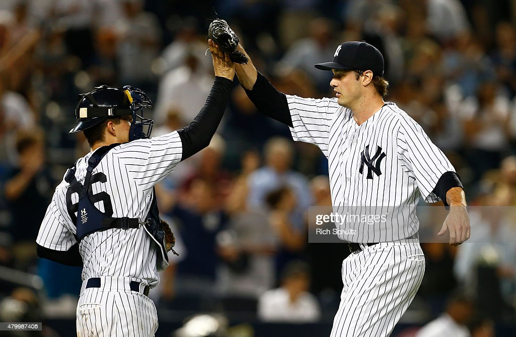 Closer Andrew Miller #48 of the New York Yankees is congratulated catcher John Ryan Murphy #66 after defeating the Oakland Athletics 5-4 during a MLB baseball game at Yankee Stadium on July 8, 2015 in the Bronx borough of New York City. The Yankees defeated the A's 5-4.