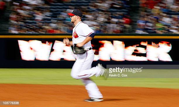 Closer Billy Wagner of the Atlanta Braves runs to the pitching mound to start the ninth inning against the New York Mets at Turner Field on September...