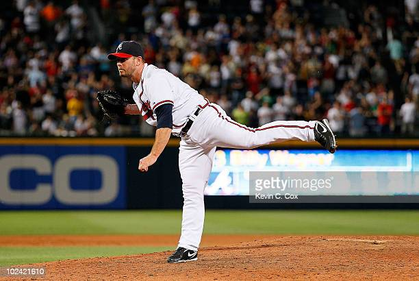 Closer Billy Wagner of the Atlanta Braves watches his pitch as he strikes out the final batter of the Detroit Tigers in the ninth inning to give him...