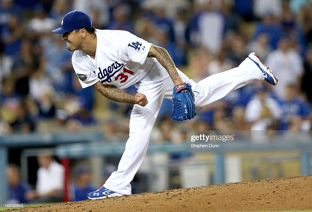 Closer <a gi-track='captionPersonalityLinkClicked' href=/galleries/search?phrase=Brandon+League&family=editorial&specificpeople=809191 ng-click='$event.stopPropagation()'>Brandon League</a> #31 of the Los Angeles Dodgers pitches in the ninth inning on his way to picking up the save against the Colorado Rockies on September 29, 2012 at Dodger Stadium in Los Angeles, California. The Dodgers won 3-0.