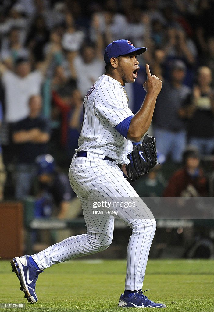 Closer <a gi-track='captionPersonalityLinkClicked' href=/galleries/search?phrase=Carlos+Marmol&family=editorial&specificpeople=556707 ng-click='$event.stopPropagation()'>Carlos Marmol</a> #49 of the Chicago Cubs celebrates after the last out against the New York Mets at Wrigley Field on June 26, 2012 in Chicago, Illinois. The Cubs defeated the Mets 5-3.
