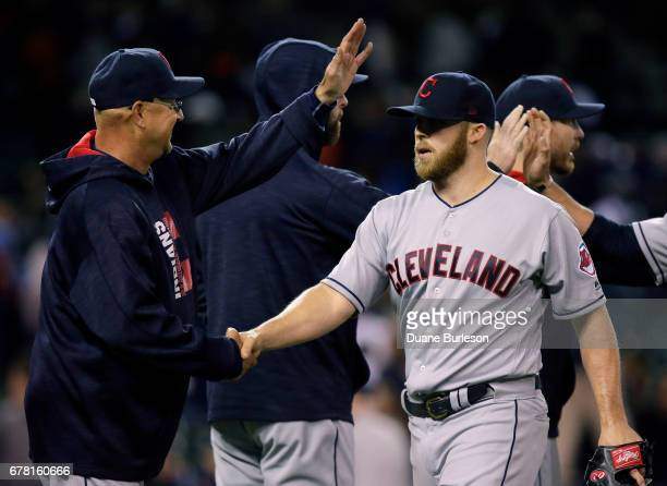 Closer Cody Allen of the Cleveland Indians is congratulated by manager Terry Francona of the Cleveland Indians after recording his seventh save in a...
