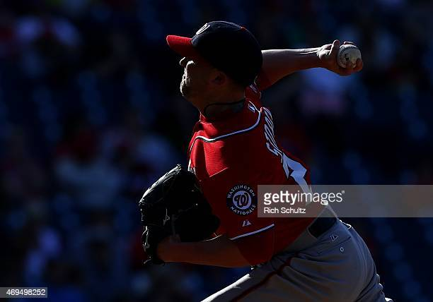Closer Drew Storen of the Washington Nationals delivers a pitch against the Philadelphia Phillies during the 11th inning The Nationals defeated the...