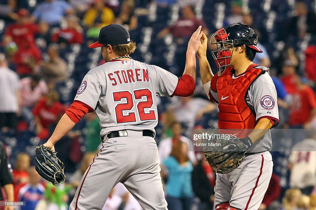 Closer <a gi-track='captionPersonalityLinkClicked' href=/galleries/search?phrase=Drew+Storen&family=editorial&specificpeople=5926519 ng-click='$event.stopPropagation()'>Drew Storen</a> #22 of the Washington Nationals is congratulated by <a gi-track='captionPersonalityLinkClicked' href=/galleries/search?phrase=Kurt+Suzuki&family=editorial&specificpeople=682702 ng-click='$event.stopPropagation()'>Kurt Suzuki</a> #24 after saving a game against the Philadelphia Phillies at Citizens Bank Park on September 26, 2012 in Philadelphia, Pennsylvania. The Nationals won 8-4.