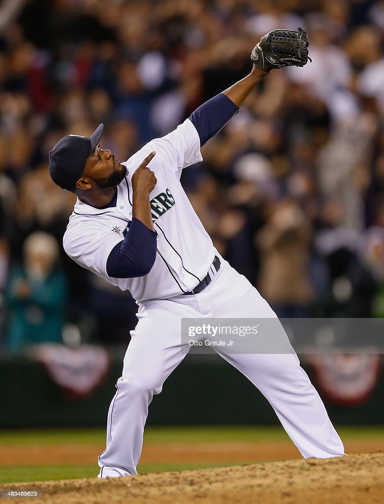 Closer <a gi-track='captionPersonalityLinkClicked' href=/galleries/search?phrase=Fernando+Rodney&family=editorial&specificpeople=547291 ng-click='$event.stopPropagation()'>Fernando Rodney</a> #56 of the Seattle Mariners celebrates after defeating the Los Angeles Angels of Anaheim 5-3 on Opening Day at Safeco Field on April 8, 2014 in Seattle, Washington.