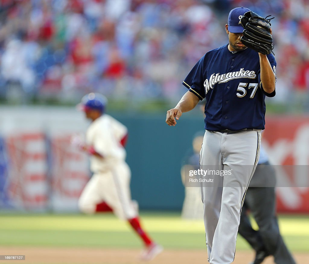 Closer Francisco Rodriguez #57of the Milwaukee Brewers covers his face after giving up a ninth inning home run to Freddy Galvis #13 of the Philadelphia Phillies who circles the bases. The Brewers defatted the Phillies 4-3 in a MLB baseball game on June 1, 2013 at Citizens Bank Park in Philadelphia, Pennsylvania.