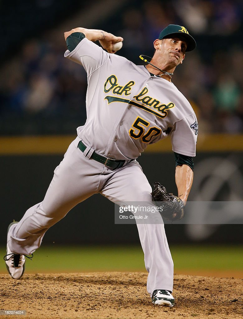 Closer <a gi-track='captionPersonalityLinkClicked' href=/galleries/search?phrase=Grant+Balfour&family=editorial&specificpeople=833980 ng-click='$event.stopPropagation()'>Grant Balfour</a> #50 of the Oakland Athletics pitches in the ninth inning against the Seattle Mariners at Safeco Field on September 27, 2013 in Seattle, Washington. The Athletics defeated the Mariners 8-2.
