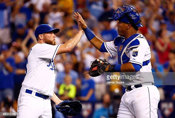 Closer Greg Holland of the Kansas City Royals is congratulated by catcher Salvador Perez after the Royals defeated the Chicago White Sox 76 to win...
