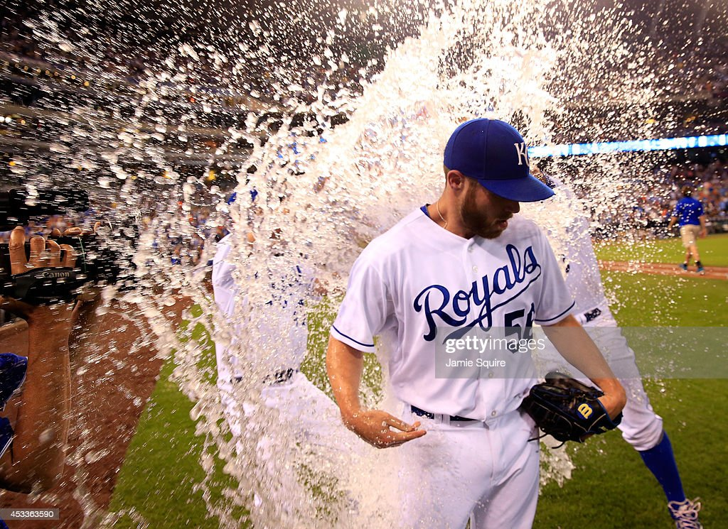 Closer Greg Holland #56 of the Kansas City Royals is doused with water by <a gi-track='captionPersonalityLinkClicked' href=/galleries/search?phrase=Danny+Duffy&family=editorial&specificpeople=5971971 ng-click='$event.stopPropagation()'>Danny Duffy</a> #41 and Salvador Perez #13 after recording his 100th career save as the Royals defeated the San Francisco Giants 4-2 to win the game at Kauffman Stadium on August 8, 2014 in Kansas City, Missouri.