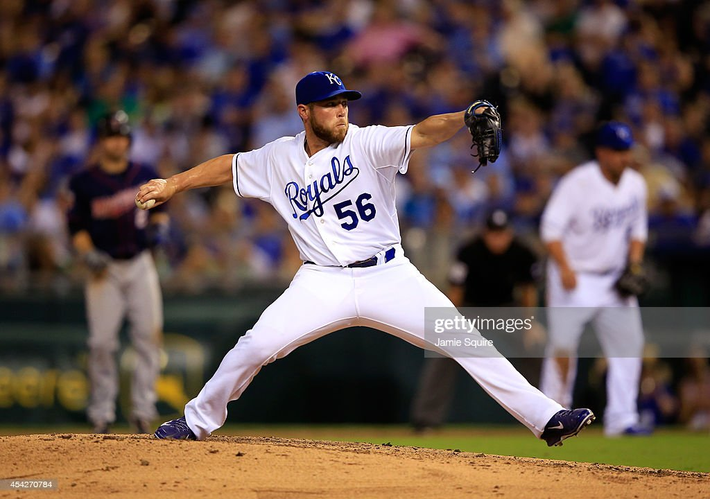 Closer Greg Holland #56 of the Kansas City Royals pitches during the 9th inning of the game against the Minnesota Twins at Kauffman Stadium on August 27, 2014 in Kansas City, Missouri.